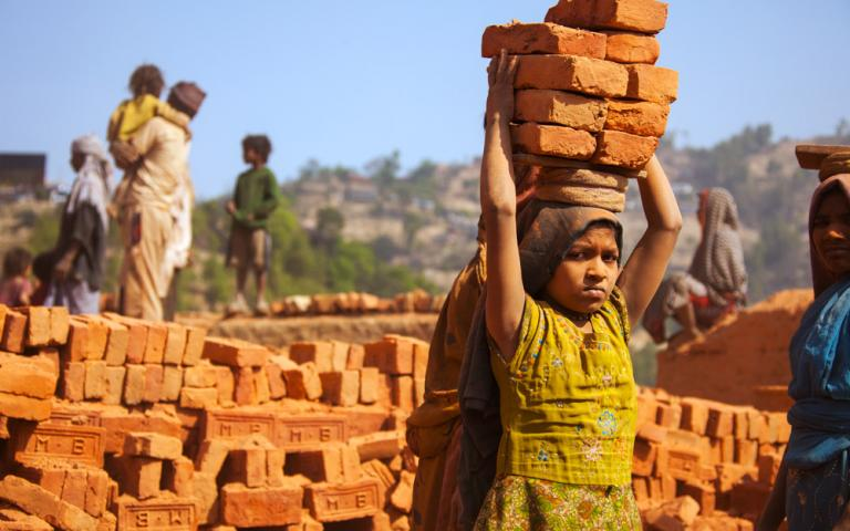 Children just like this young girl suffer verbal and physical abuse while working up to 16 hours a day at brick factory.
