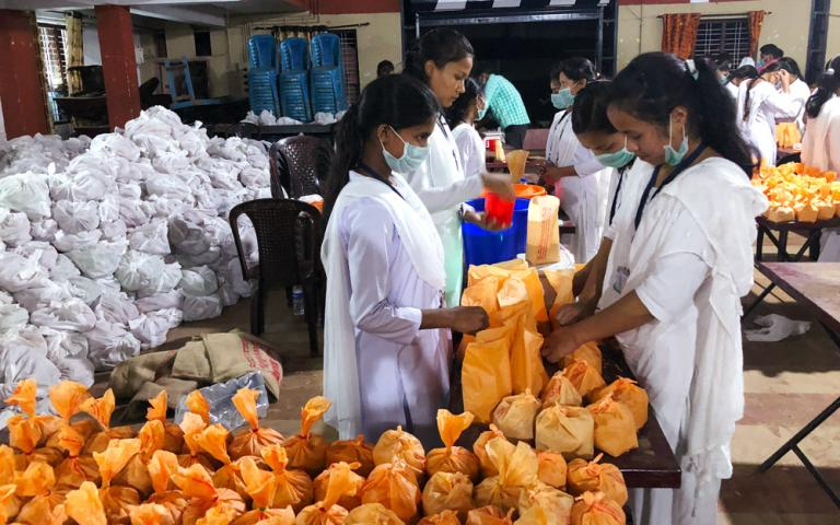 Gospel for Asia-supported workers (in a ministry (founded by Dr. K.p. Yohannan) assisted government relief efforts after the Kerala flooding in August 2018. Here they are assembling packages of food items and other essential supplies to distribute to flood victims.