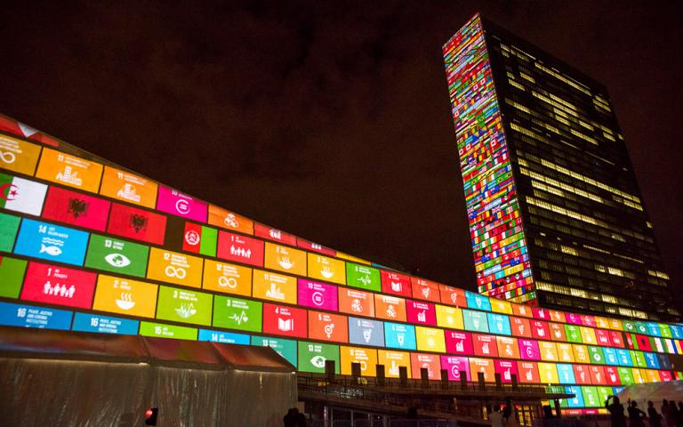 Gospel for Asia shares: The United Nations Building in New York in 2015, displaying the UN's development goals and the flags of the 193 countries that agreed to them.