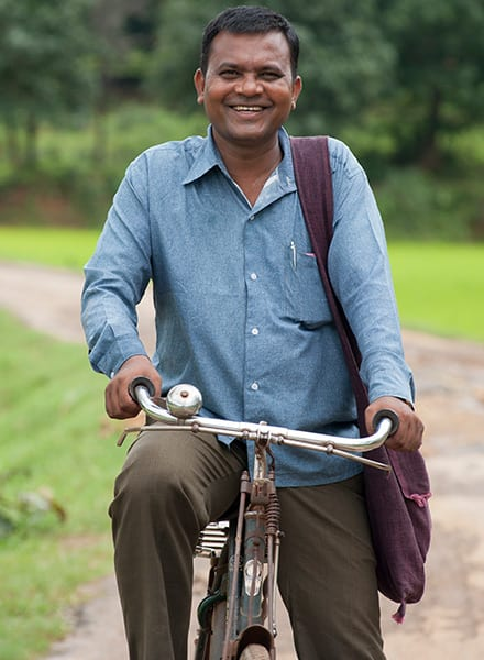 A bicycle played a vital role in Pastor Roshan (pictured) and his wife's ministry. Bicycles offer reliable transportation and help many other national workers, breadwinners and schoolchildren alike to accomplish their day's goals.