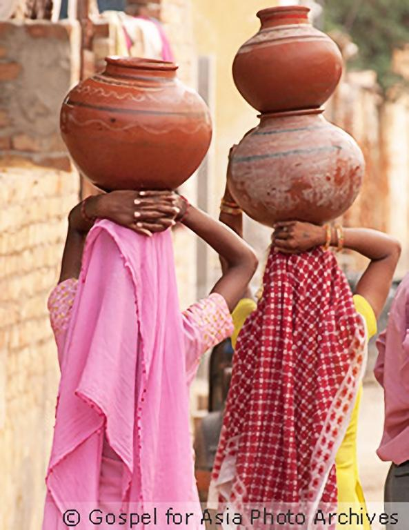 Carrying heavy pots of water is a common sight in many Asian communities—a task made even harder the farther the distance one has to walk.