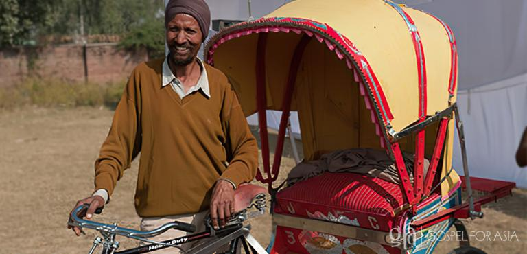 Gospel for Asia founded by Dr. K.P. Yohannan: The rickshaws given to this man and to Khadim bring smiles to their faces and remind them of God's love and care for their families.