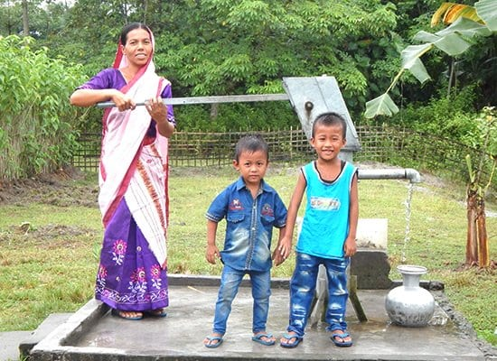 Gospel for Asia founded by Dr. K.P. Yohannan: Salil's wife and children pumping water from the Jesus Well.