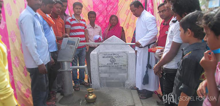 Gospel for Asia founded by Dr. K.P. Yohannan: After the Jesus Well in Pastor Sahay's village was completed (pictured), it was dedicated to the Lord. This well pours out clean water freely to those who come to it for a drink.
