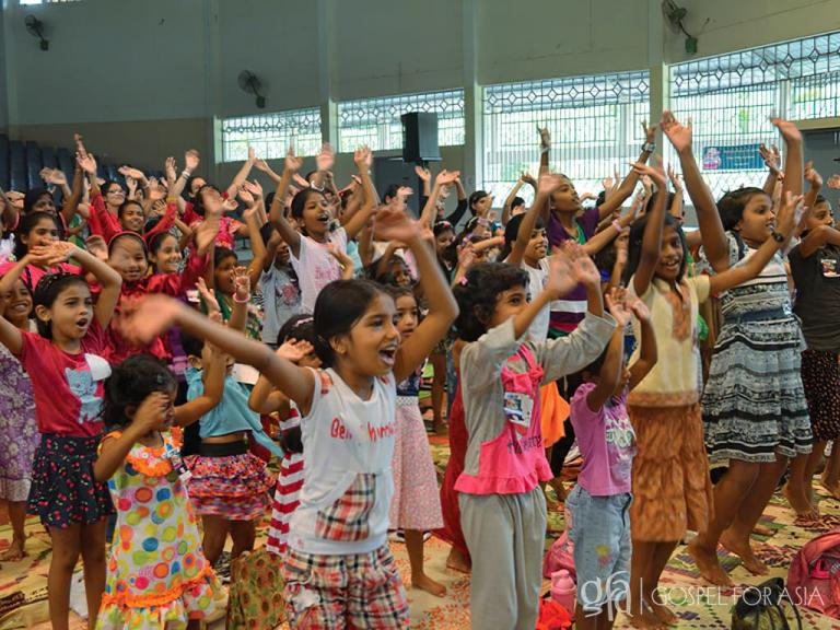 GFA founded by Dr. K.P. Yohannan: Discussing Gospel for Asia Vacation Bible School, teaching children to be a better friend, & some to become friends with Jesus, the truest Friend of all.