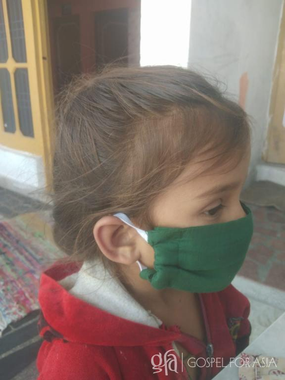 """Gospel for Asia (GFA World and affiliates like Gospel for Asia Canada) founded by Dr. K.P. Yohannan: This girl told Bindhiya, """"Thank you, didi [older sister], for this mask."""""""