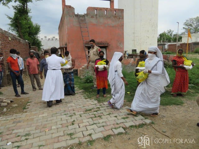 Gospel for Asia (GFA World and affiliates like Gospel for Asia Canada) founded by Dr. K.P. Yohannan: Sisters of Compassion distribute groceries in a slum.