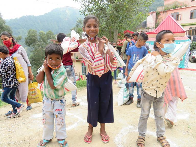 Gospel for Asia - GFA World - helps to distribute food kits to more than 70,000 utterly desperate families to defy COVID 19 starvation