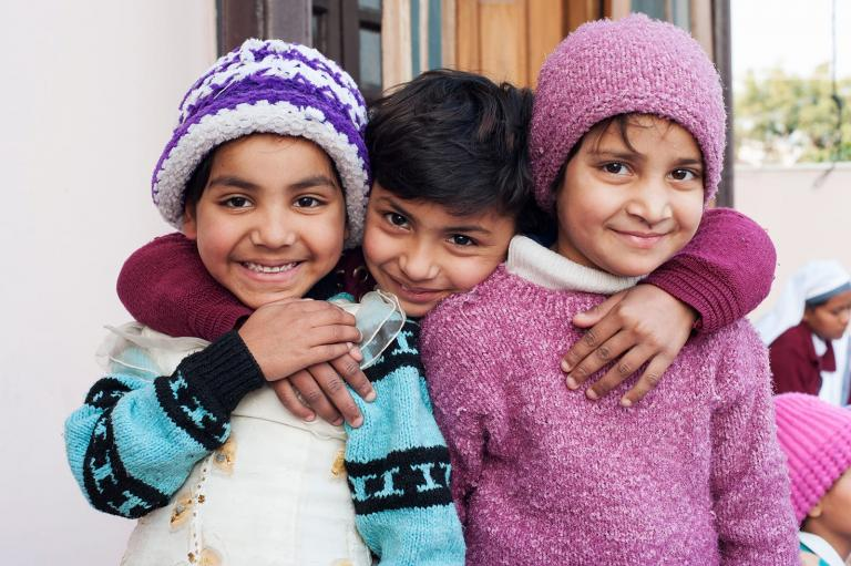 Ashmita, a girl rescued from trafficking, can now smile in safety with friends.