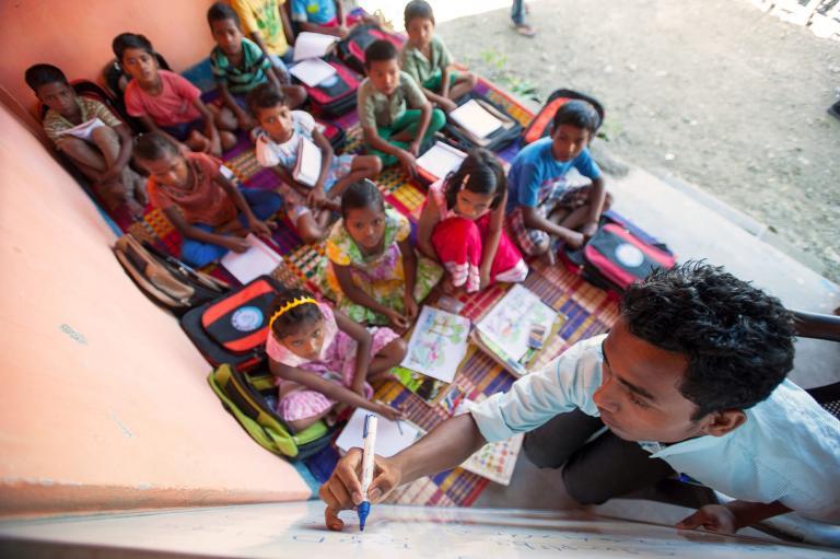 Children listening intently in Bridge of Hope center class
