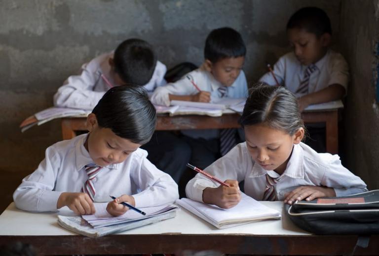 Children studying in Bridge of Hope Center