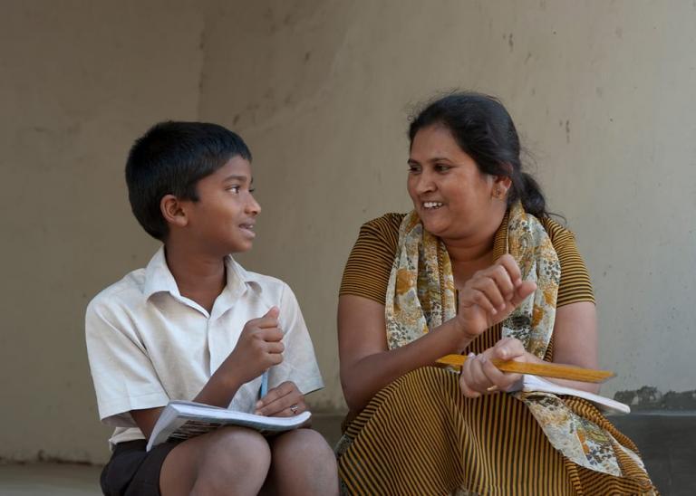 Bridge of Hope teacher with student