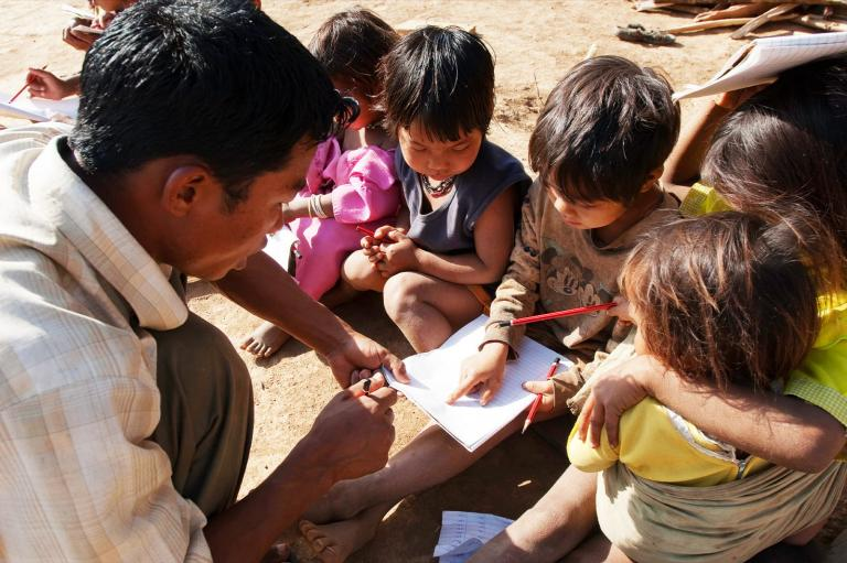 GFA Pastor teaching children by the street