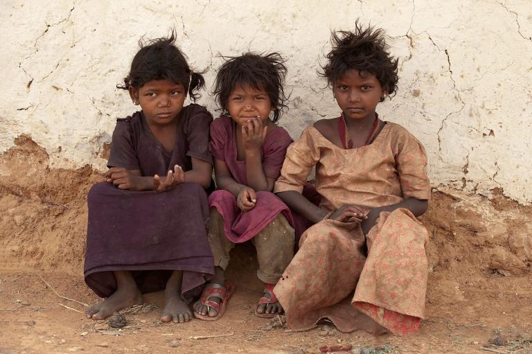 A group of three poor girls