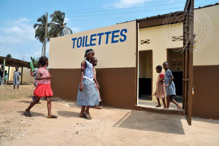 Children investigate new toilet