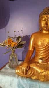 My Buddha and flowers 050917