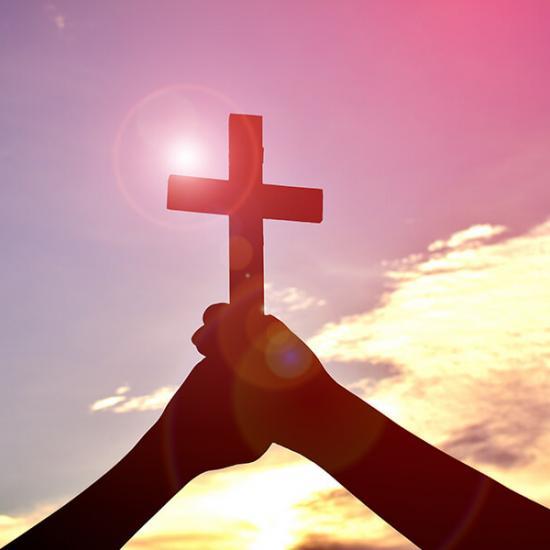 Faith-Christian-Cross-Hands-Sky-Sun-Glare_credit-Shutterstock
