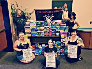 Members of TST-AZ with donated products for the Menstruatin' with Satan Campaign