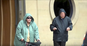 Rev. John Wilson and Wife, Mary, exit court while trial was ongoing. Image Source: Screenshot via YouTube