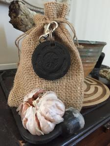 Bag containing the prepared keys and a small offering to Hekate.