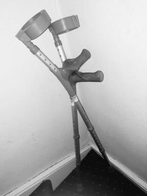 a pair of crutches lean against a corner