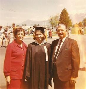 College graduate with fathers and mother