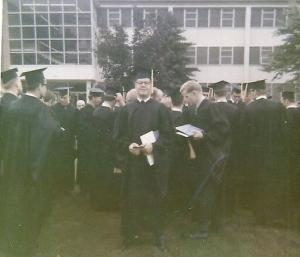 Man in cap and gown at graduation