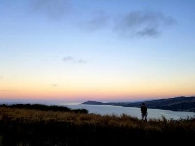 Sunrise over the land and sea