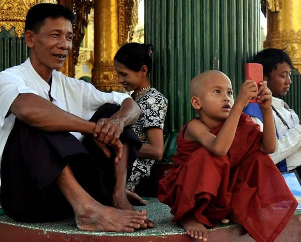 Burma - Rangoon 2011 - young monk with a game