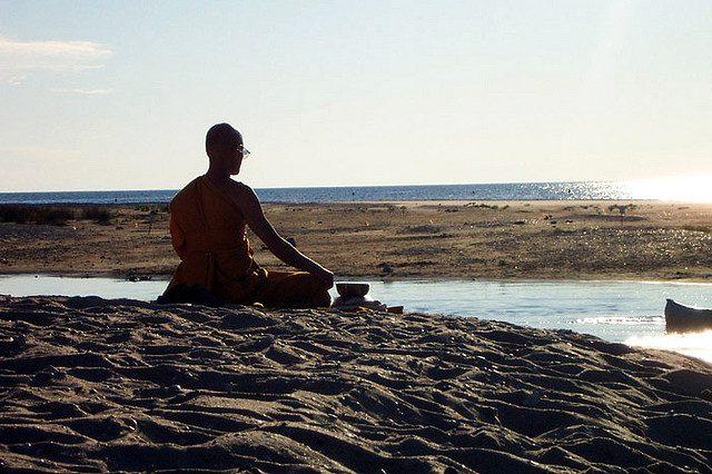 Achahn Chuen meditation; on a beach near Traverse City, MI (photo by Brian Ambrozy, flickr C.C.)