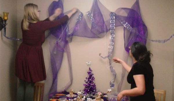 (Solaris and I decorate the Yule Altar)