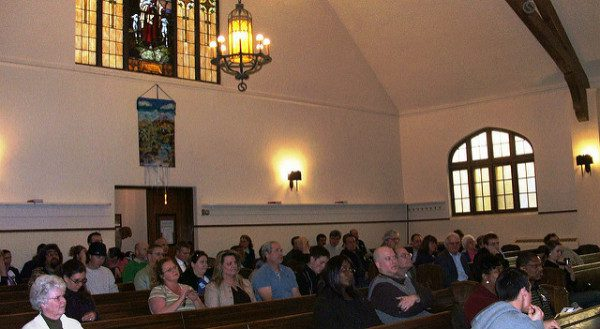 Crowd Gathers in House of Worship. photo by by AFL-CIO. (cc) 2004.