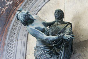 statue of woman dancing with a dead man