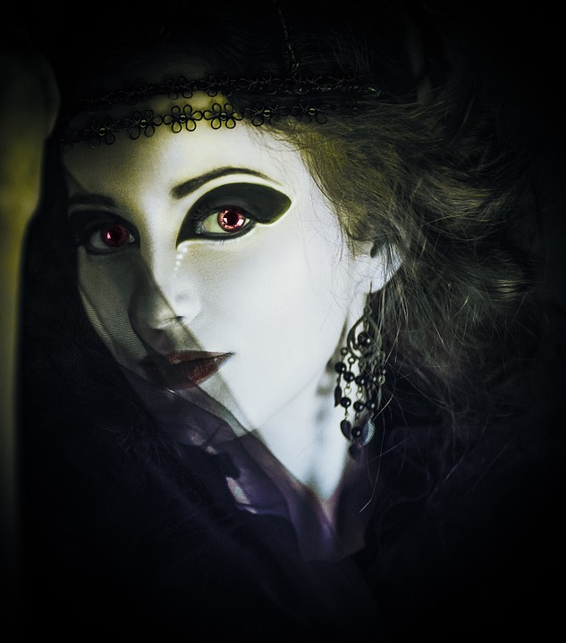 image of a white white woman with black eye makeup and a black veil