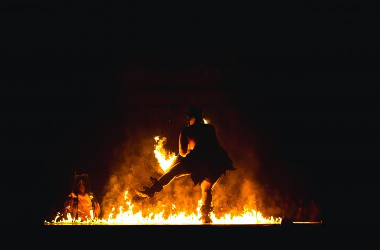 dancing figure before fire