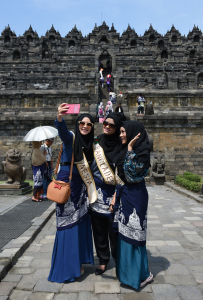 Finalists of the World Muslimah Competition pose for a selfie in front of the Borobudur temple on Java, Indonesia. Image by Adek Berry/AFP