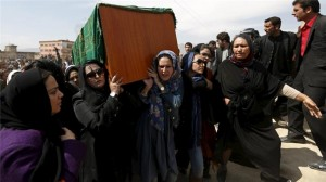 Afghan women carry body of lynched woman to burial. Source.