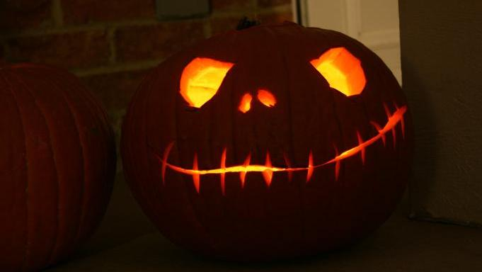 A carved jack o'lantern lit from within