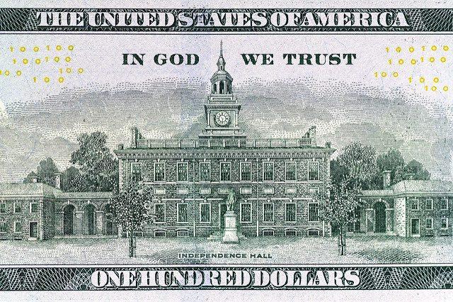 god trust money political