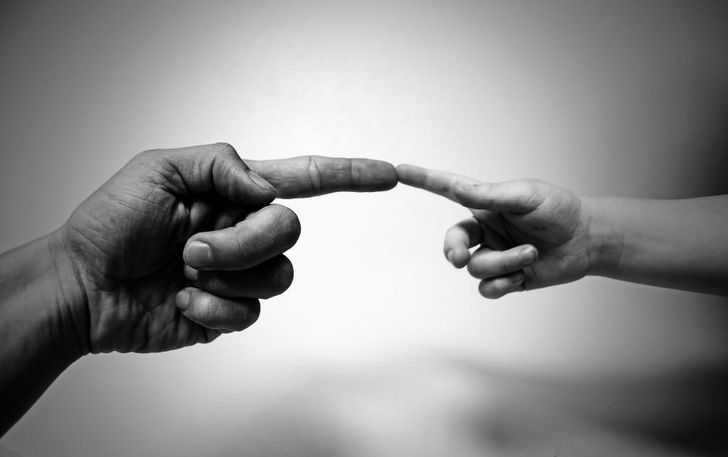 Two fingers touching (CC0 via pixabay)