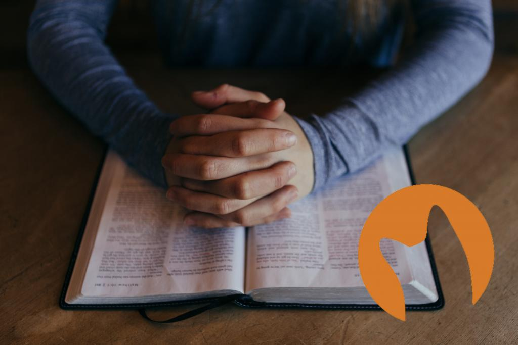 Hands praying over Bible (Photo by Patrick Fore on Unsplash CC0, Logo by CuriousCat FairUse)