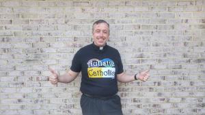 """Me wearing my """"Autistic Catholic"""" shirt over my clerics."""
