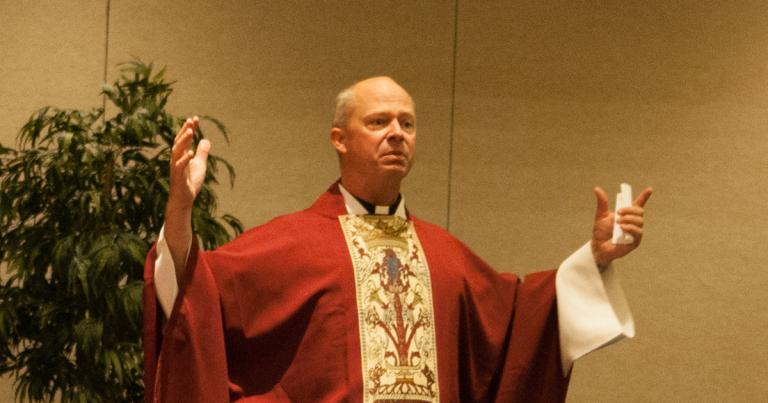 Fr. Chad Zielinski preaching as an air force chaplain (CC0 government photo)