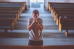 Young man praying (CC0 pixabay)