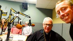 Bishop Hying, Deacon Jim Hoegemeier, a young woman who works in disability ministry their with her fiancee and myself in the studio recording this segment