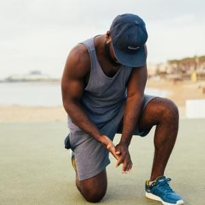 Man Praying in workout clothes