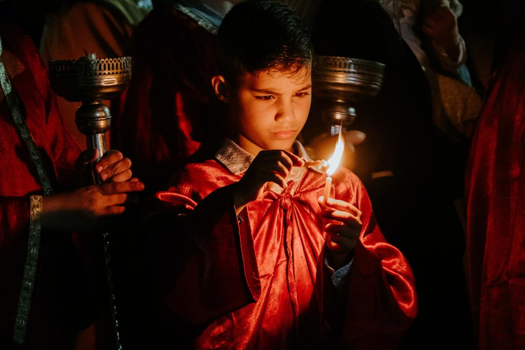 Boy holding candle