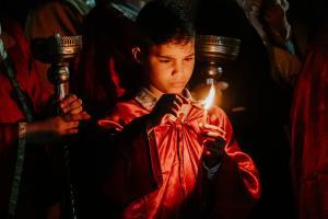 Boy holding candle
