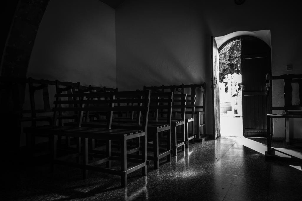 Church door open with light streaming in