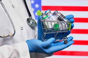 Various vaccines in front of an American Flag